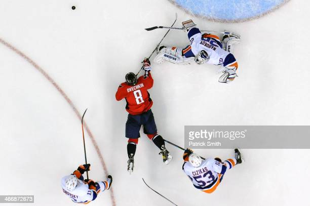 Goalie Evgeni Nabokov of the New York Islanders makes a save on Alex Ovechkin of the Washington Capitals in the third period at the Verizon Center on...