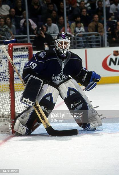 Goalie Felix Potvin of the Los Angeles Kings defends the net during an NHL game circa 2001 at the Staples Center in Los Angeles California