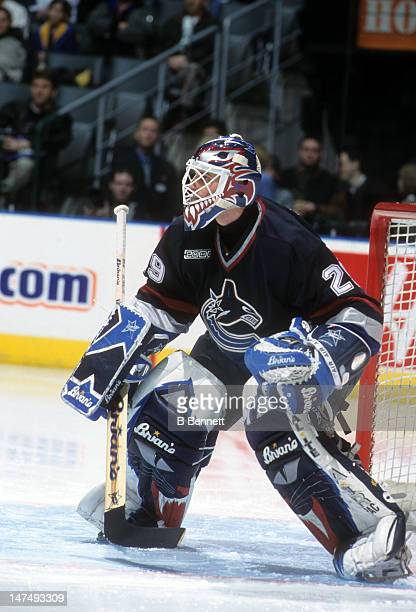 Goalie Felix Potvin of the Vancouver Canucks defends the net during an NHL game against the Toronto Maple Leafs on February 12 2000 at the Air Canada...