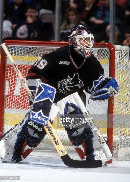 Goalie Felix Potvin of the Vancouver Canucks defends the net during an NHL game against the Edmonton Oilers on December 4 1999 at the Skyreach Centre...