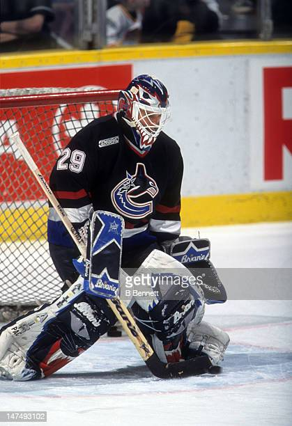 Goalie Felix Potvin of the Vancouver Canucks makes a save during warmups before their game against the Edmonton Oilers on March 25 2000 at the...