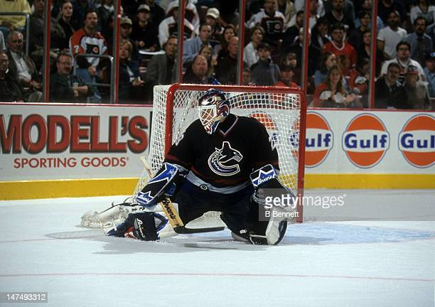 Goalie Felix Potvin of the Vancouver Canucks makes the save during an NHL game against the Philadelphia Flyers on October 5 2000 at the First Union...
