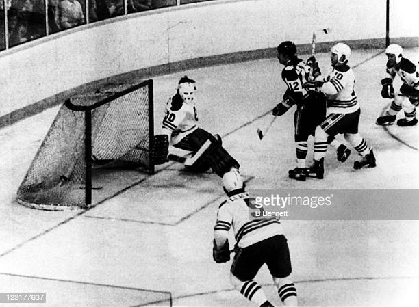 Goalie Gary Bromley of the Winnipeg Jets makes the save off of Mike Antonovich of the New England Whalers as Peter Sullivan of the Jets pushes him...