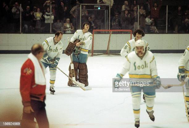 Goalie Gary 'Cobra' Simmons of the California Golden Seals skates off the ice with his teammates after their game against the Montreal Canadiens on...