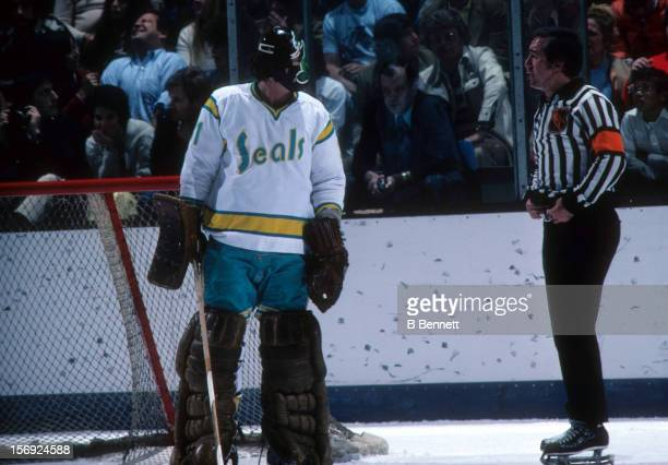 Goalie Gary 'Cobra' Simmons of the California Golden Seals talks to the referee during an NHL game against the Montreal Canadiens on March 19 1976 at...
