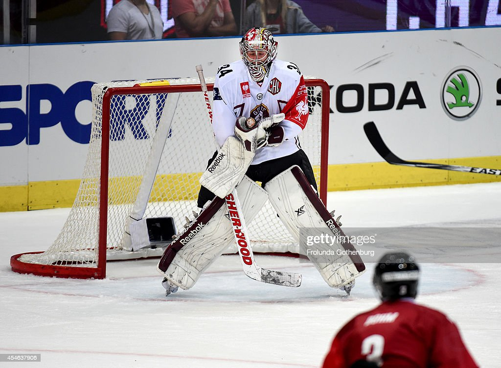 Goalie Gauthier Descloux #34 of Geneve-Servette makes a save during the Champions Hockey League group stage game against Frolunda September 4, 2014 in Gothenburg, Sweden.