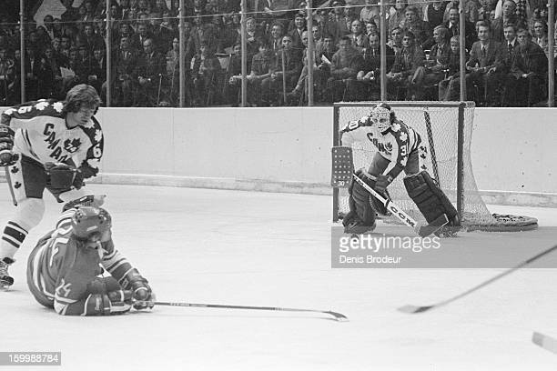 Goalie Gerry Cheevers guards the goal while Brad Selwood team Canada checks Alexander Bodunov of the Soviet Union during Summit Series game...