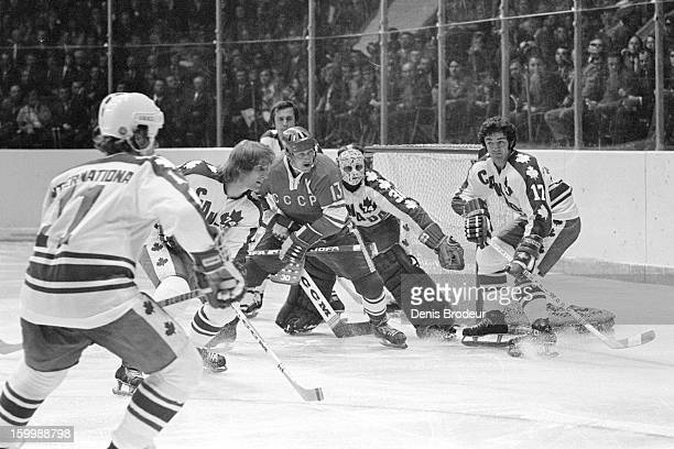 Goalie Gerry Cheevers guards the goal while Rick Smith, Paul Schmyr and Marke Hoe of team Canada try to keep the puck away from Boris Mikhailov of...