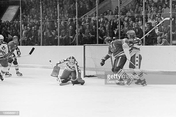 Goalie Gerry Cheevers of team Canada grabs ahold of the puck against Boris Mikhailov of the Soviet Union during a Summit Series game September, 1974...