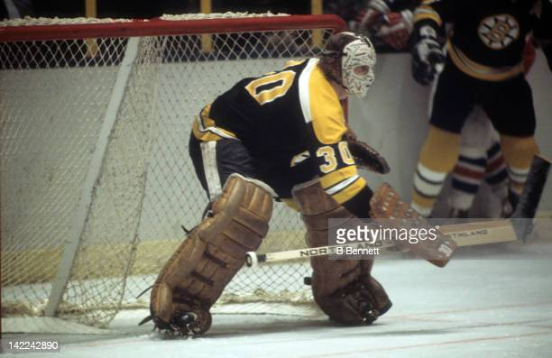 Goalie Gerry Cheevers of the Boston Bruins defends the net during an NHL game against the New York Rangers circa 1974 at the Madison Square Garden in...