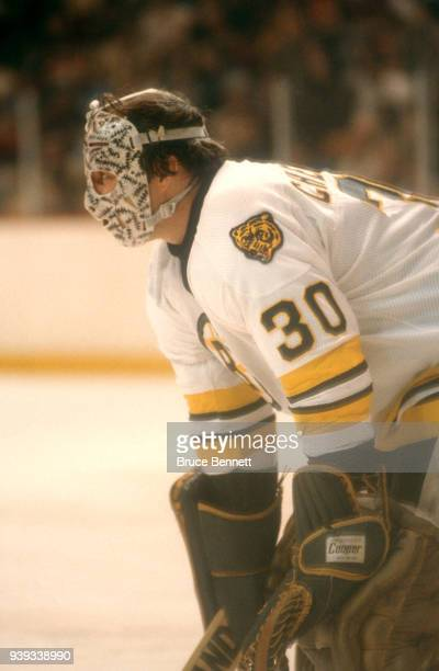 Goalie Gerry Cheevers of the Boston Bruins defends the net during an NHL game circa 1980 at the Boston Garden in Boston, Massachusetts.