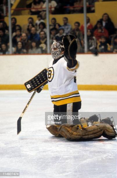 Goalie Gerry Cheevers of the Boston Bruins looks to make the save during an NHL game circa 1980 at the Boston Garden in Boston Massachusetts