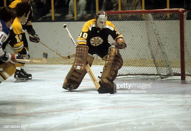 Goalie Gerry Cheevers of the Boston Bruins looks to pass the puck during an NHL game against the New York Rangers on February 2, 1972 at the Madison...