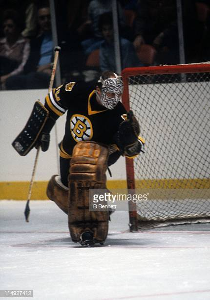 Goalie Gerry Cheevers of the Boston Bruins makes the save during an NHL game in December, 1979.