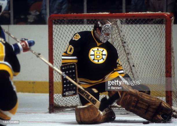 Goalie Gerry Cheevers of the Boston Bruins makes the save during an NHL game against the New York Rangers on December 23, 1979 at the Madison Square...