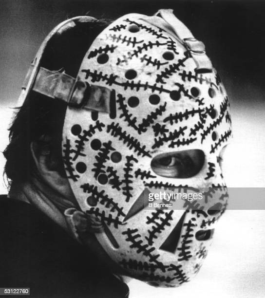Goalie Gerry Cheevers of the Boston Bruins peers out from behind his mask during the Bruins practice session on May 20, 1978 before Game 4 of the...