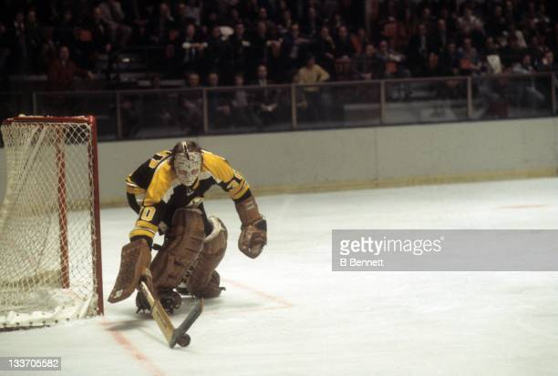 Goalie Gerry Cheevers of the Boston Bruins stops the puck during an NHL game against the New York Rangers circa 1979 at the Madison Square Garden in...