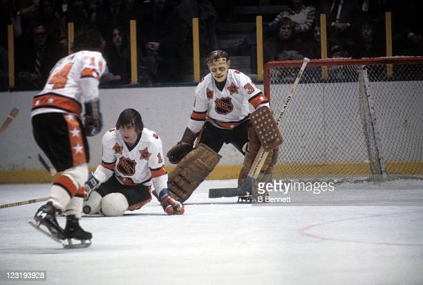 Goalie Gilles Villemure of the New York Rangers and Serge Savard of the Montreal Canadies both from Team East defend the net during the 26th NHL...