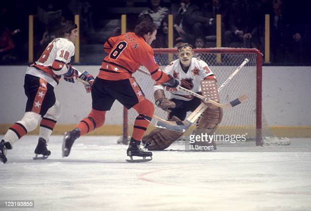 Goalie Gilles Villemure of the New York Rangers and Team East defends the net against Jim Pappin of the Chicago Blackhawks and Team West as Serge...