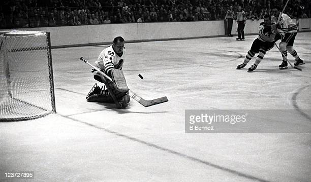 Goalie Glen Hall of the Chicago Blackhawks makes the save during an NHL game against the Boston Bruins circa 1967 at the Boston Garden in Boston...