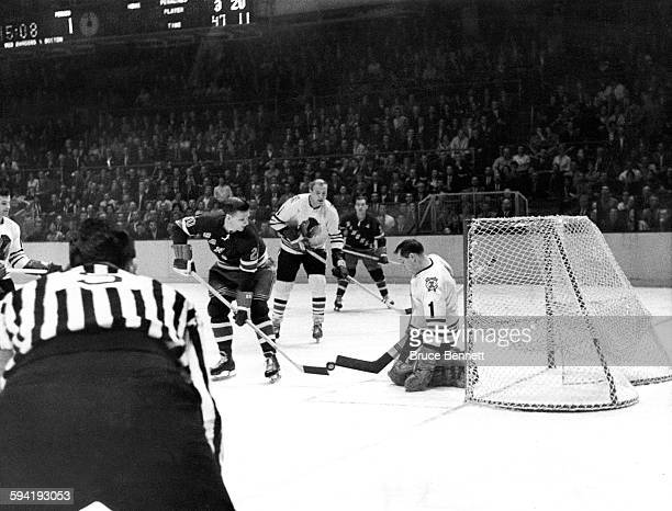 Goalie Glenn Hall of the Chicago Blackhawks and Phil Goyette of the New York Rangers battle for the puck on October 27 1963 at the Madison Square...
