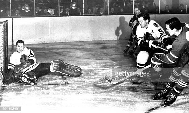 Goalie Glenn Hall of the Chicago Blackhawks can't make the save on the shot by Frank Mahovlich of the Toronto Maple Leafs as Hall's teammate Jack...
