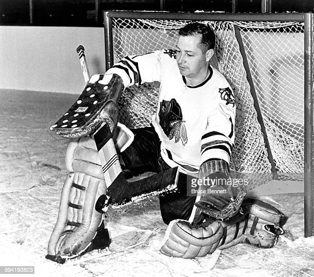1964 Goalie Glenn Hall of the Chicago Blackhawks makes a save during a portrait session circa 1964
