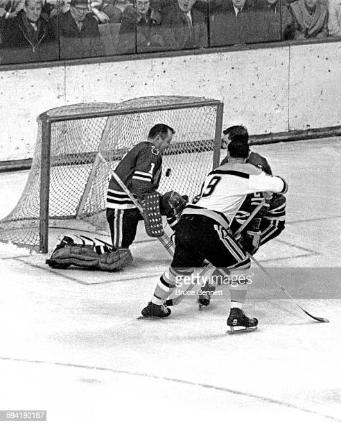 Goalie Glenn Hall of the Chicago Blackhawks makes the save on Johnny Bucyk of the Boston Bruins as Doug Jarrett of the Blackhawks defends on March 2...