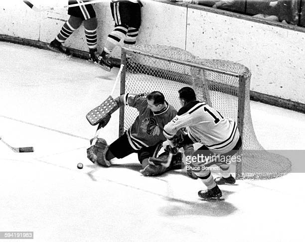 Goalie Glenn Hall of the Chicago Blackhawks makes the save on Ron Stewart of the Boston Bruins on March 23 1966 at the Boston Garden in Boston...