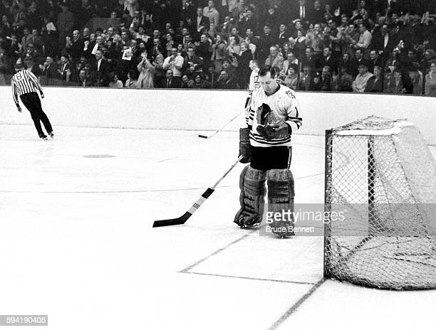 Goalie Glenn Hall of the Chicago Blackhawks stands in the crease after the Detroit Red Wings scored during Game 3 of the 1964 SemiFinal game on March...