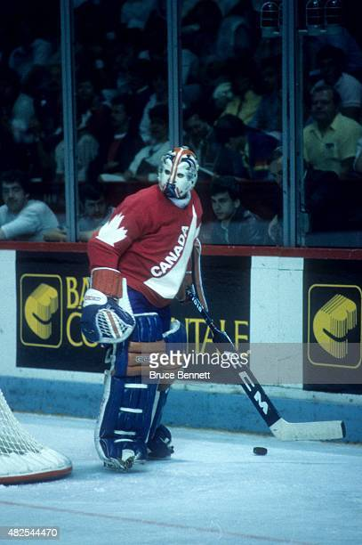 Goalie Grant Fuhr of Team Canada handles the puck behind the net during the 1984 Canada Cup against Team West Germany on September 1, 1984 at the...