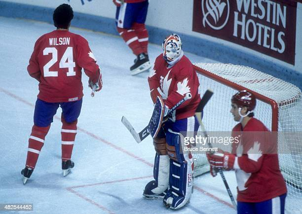 Goalie Grant Fuhr of Team Canada stands on the ice net before the 1984 Canada Cup against Team West Germany on September 1, 1984 at the Montreal...
