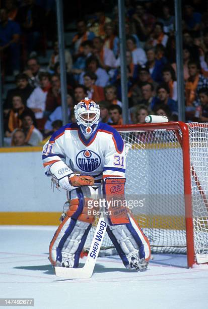 Goalie Grant Fuhr of the Edmonton Oilers defends the net during an NHL game circa 1989 at the Northlands Coliseum in Edmonton Alberta Canada