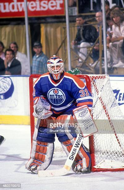 Goalie Grant Fuhr of the Edmonton Oilers defends the net during an NHL game against the Los Angeles Kings on October 25 1988 at the Great Western...