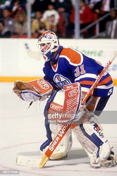 Goalie Grant Fuhr of the Edmonton Oilers defends the net during an NHL game against the Hartford Whalers on December 1 1990 at the Hartford Civic...
