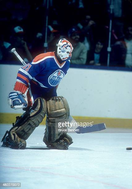 Goalie Grant Fuhr of the Edmonton Oilers looks to make the save during an1984 Stanley Cup Finals game against the New York Islanders in May 1984 at...