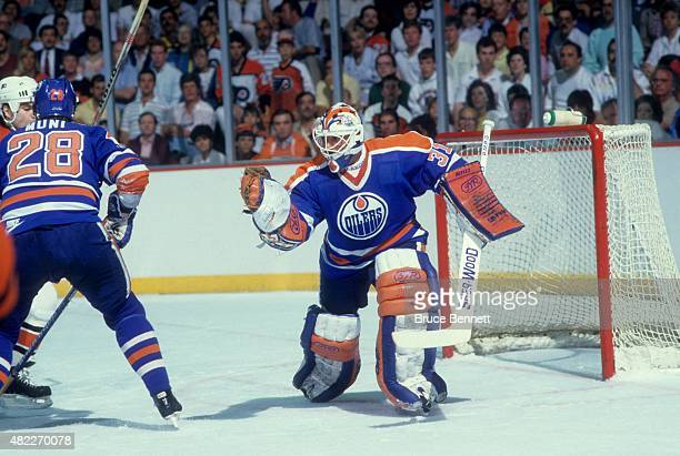 Goalie Grant Fuhr of the Edmonton Oilers makes the glove save during an 1987 Stanley Cup Finals game against the Philadelphia Flyers in May 1987 at...