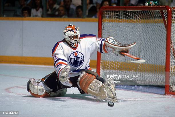 Goalie Grant Fuhr of the Edmonton Oilers makes the save during an NHL game in 1981 at the Northlands Coliseum in Edmonton Alberta Canada