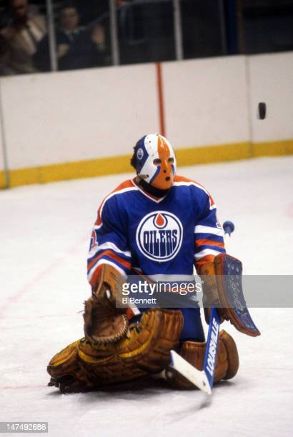 Goalie Grant Fuhr of the Edmonton Oilers makes the save during an NHL game against the New York Islanders on November 14 1981 at the Nassau Coliseum...