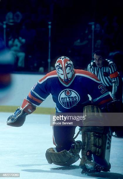 Goalie Grant Fuhr of the Edmonton Oilers makes the save during an1984 Stanley Cup Finals game against the New York Islanders in May 1984 at the...
