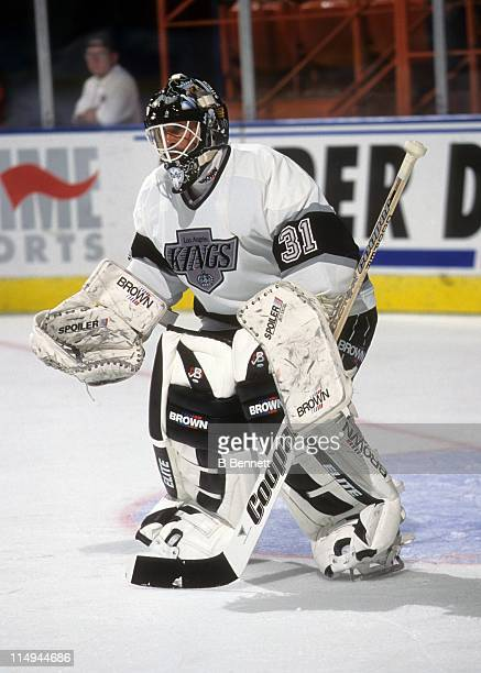 Goalie Grant Fuhr of the Los Angeles Kings defends the net during an NHL game in March 1995 at the Great Western Forum in Inglewood California