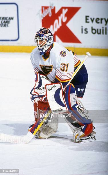 Goalie Grant Fuhr of the St Louis Blues defends the net during an NHL game against the Detroit Red Wings on March 31 1996 at the Joe Louis Arena in...