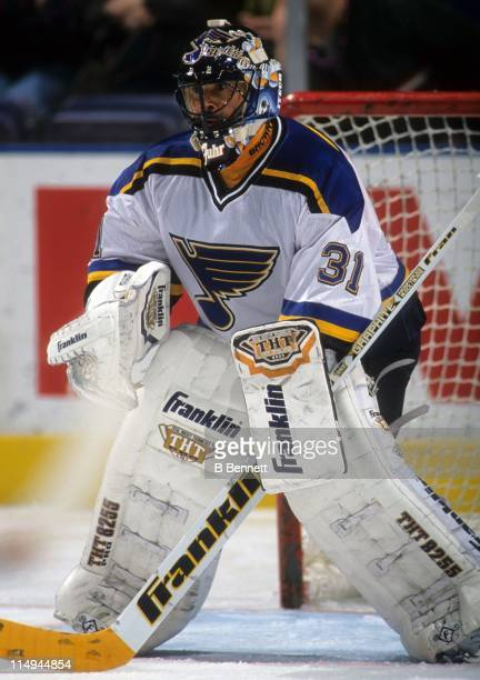 Goalie Grant Fuhr of the St Louis Blues defends the net during an NHL game circa 1997 at the Kiel Center in St Louis Missouri