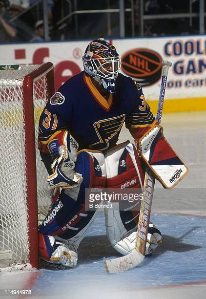Goalie Grant Fuhr of the St Louis Blues defends the net during an NHL game against the New York Rangers on October 18 1996 at the Madison Square...