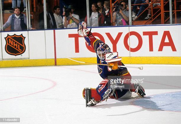 Goalie Grant Fuhr of the St Louis Blues makes the save during an NHL game against the Los Angeles Kings in 1997 at the Great Western Forum in...