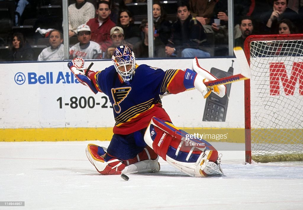 Goalie Grant Fuhr #31 of the St. Louis Blues makes the save during an NHL game against the New Jersey Devils in 1998 at the Contenental Airlines Arena in East Rutherford, New Jersey.