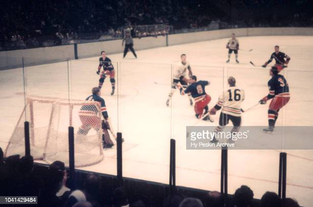 Goalie Gump Worsley Lou Fontinato Harry Howell of the New York Rangers and Bobby Hull of the Chicago Blackhawks look up for the puck during an NHL...