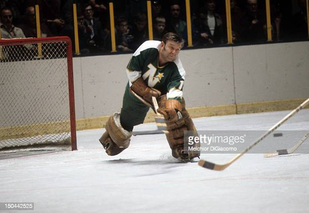 Goalie Gump Worsley of the Minnesota North Stars looks to clear the puck during an NHL game against the New York Rangers circa 1972 at the Madison...