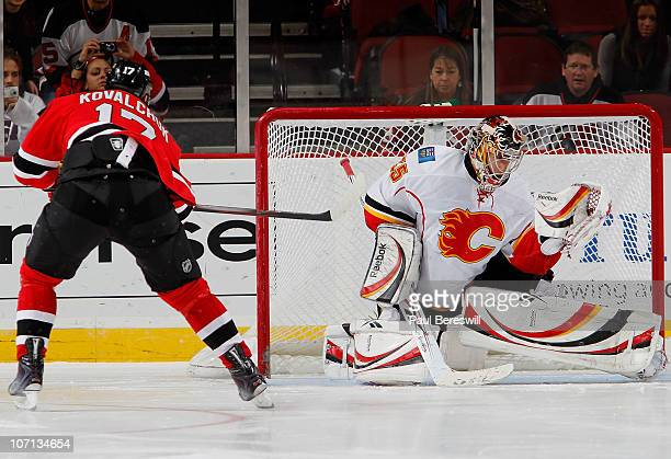 Goalie Henrik Karlsson of the Calgary Flames misses on the shot by Ilya Kovalchuk of the New Jersey Devils for the only goal of the shootout period...