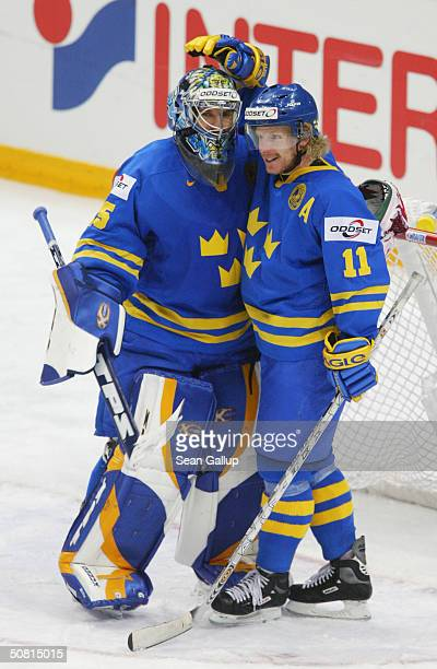 Goalie Henrik Lundqvist and forward Daniel Alfredsson of Sweden celebratetheir victory over the USA in the teams' semi-finals match at the...